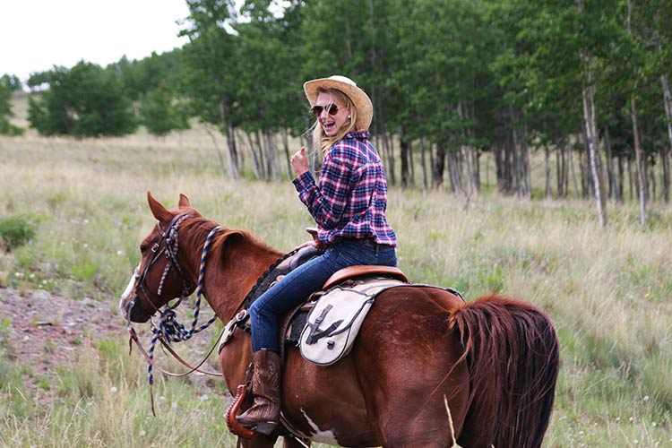 dude ranch for families - teen on horse